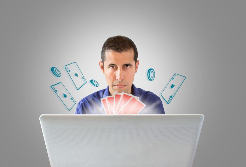 man playing casino games online